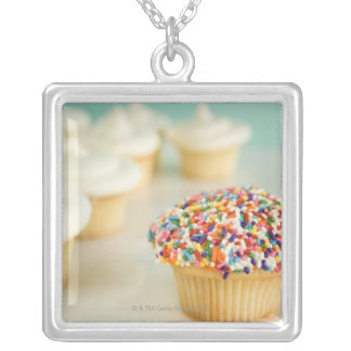 Cupcakes, focus on one in front with silver plated necklace