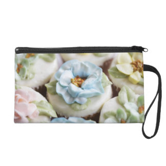 Cupcakes with flower icing wristlet clutches