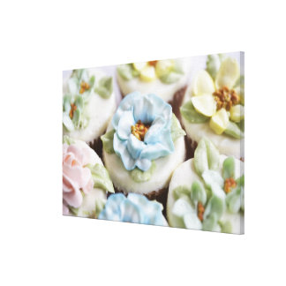 cupcakes with flower icing canvas print
