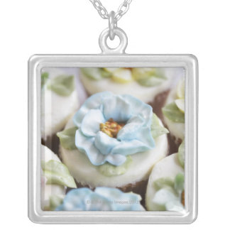 cupcakes with flower icing silver plated necklace