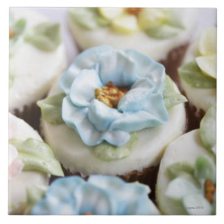 Cupcakes with flower icing tile