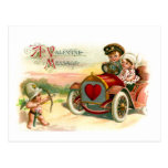Cupid's Arrow Points at Couple in Car Postcards