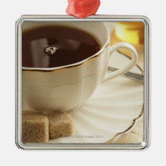 Cups of coffee and sugar. Silver-Colored square decoration