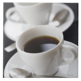 Cups of coffee with saucer tile