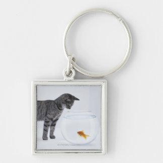 Curious cat watching goldfish in fishbowl key ring