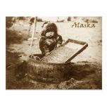 Curious Eskimo child with washboard Postcard