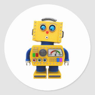 Curious toy robot looking down classic round sticker