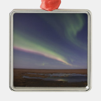 Curtains of colored northern lights christmas ornament