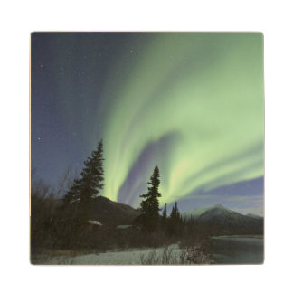 Curtains of green aurora borealis in the sky 2 wood coaster