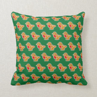 Cushion with robin gingerbread on green