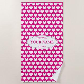 Custom beach towel with hot pink heart pattern