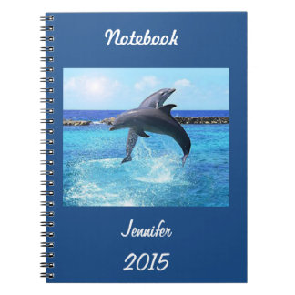 Custom dolphins playing in the ocean doing tricks spiral note books