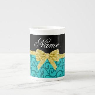 Custom name turquoise swirls gold bow bone china mug