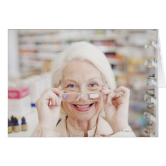 Customer trying in prescription eyeglasses in card