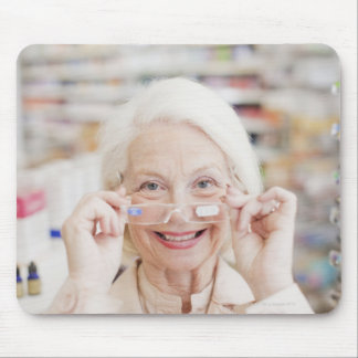 Customer trying in prescription eyeglasses in mouse mat