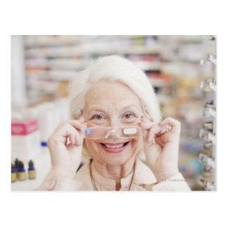 Customer trying in prescription eyeglasses in postcard