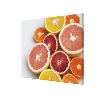 Cut Oranges on table Canvas Print