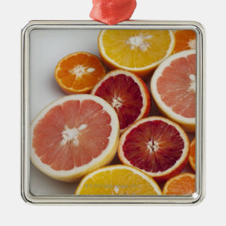 Cut Oranges on table Christmas Ornament