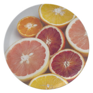 Cut Oranges on table Plate