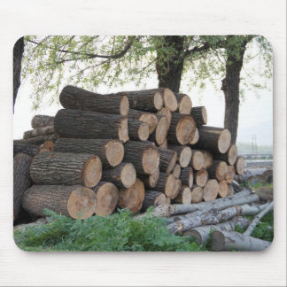Cut tree trunks piled up for further processing mousepad