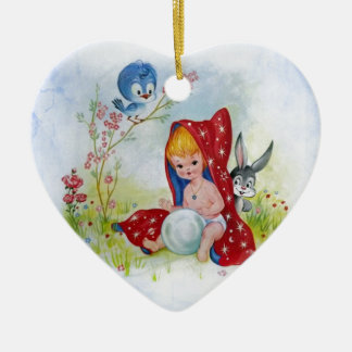 Cute adorable little boy, bunny and bird playing christmas ornament