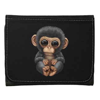 Cute and Curious Baby Chimpanzee on Black Wallets