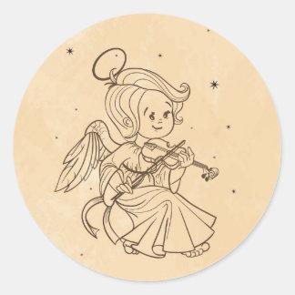 Cute angel playing violin round sticker