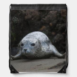 Cute Baby Harbor Seal crawling across Beach Drawstring Backpack