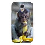 Cute baby macaque monkey eating banana HTC vivid covers
