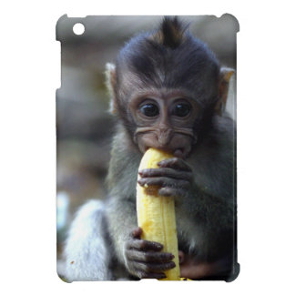 Cute baby macaque monkey eating banana iPad mini cover