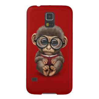 Cute Baby Monkey Reading a Book on Red Galaxy S5 Cover