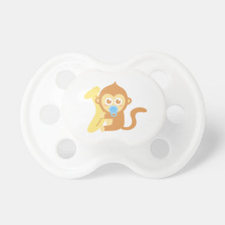 Cute Baby Monkey With Banana Dummy