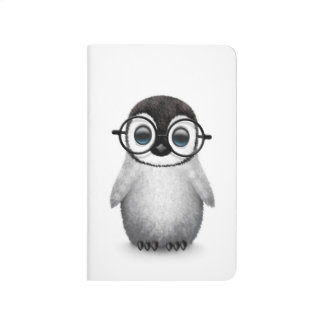Cute Baby Penguin Wearing Eye Glasses on White Journals