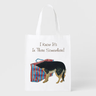 Cute black and tan dog with head in shopping bag