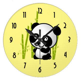 Cute black and white panda bear in a bamboo grove. large clock
