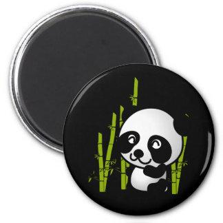 Cute black and white panda bear in a bamboo grove. refrigerator magnet