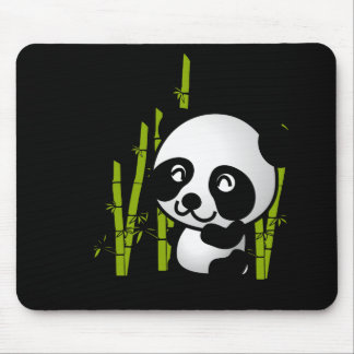Cute black and white panda bear in a bamboo grove. mouse mat