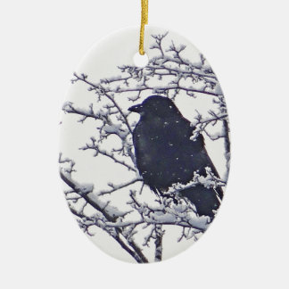 Cute black bird in snowy branches ceramic oval decoration