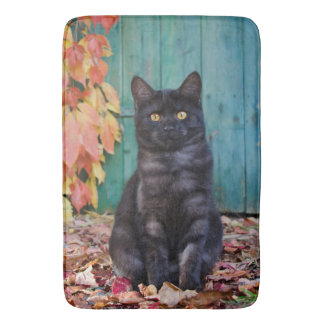 Cute Black Cat Kitten with Red Leaves Blue Door .- Bath Mat