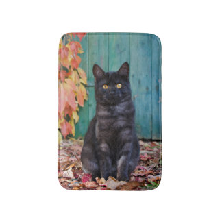 Cute Black Cat Kitten with Red Leaves Blue Door . Bath Mat
