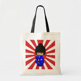 Cute Blue  Kokeshi Doll on rising sun