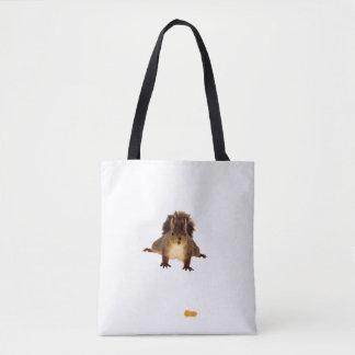 Cute brown squirrel in snow tote bag