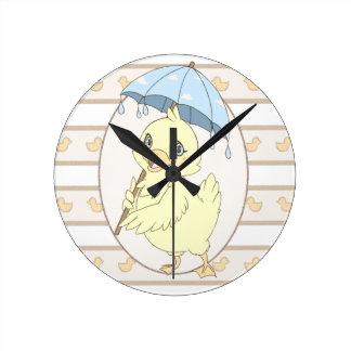 Cute cartoon duckling with umbrella wall clock