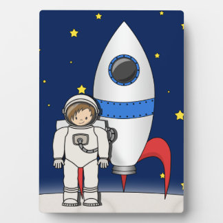 Cute Cartoon Spaceman and Rocket Ship Plaque
