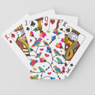cute colorful parrot bird playing cards