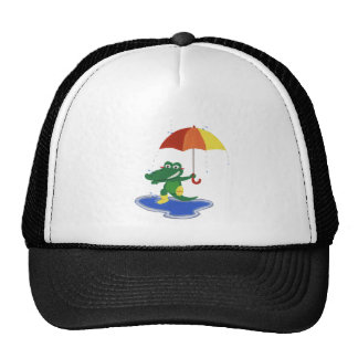 Cute crocodile under the rain cap