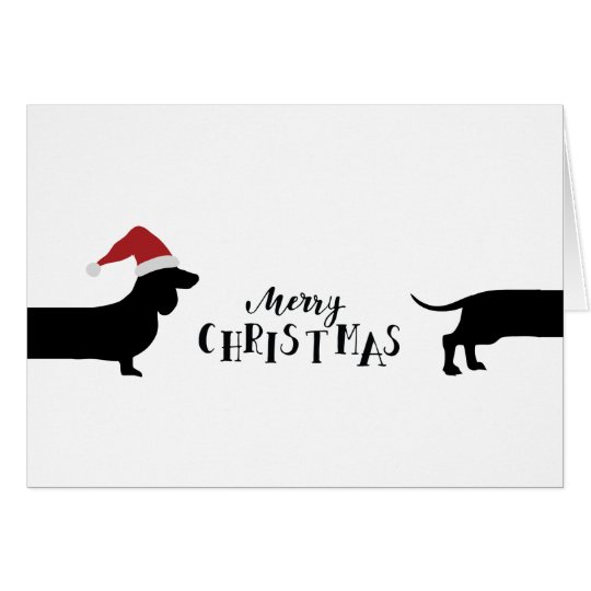 Cute dachshund with santa hat Merry Christmas Card