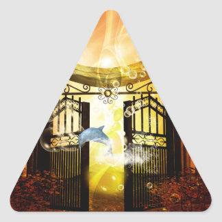 Cute dolphin jumping by a gate triangle sticker