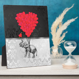 Cute elephant and love heart on gray plaque
