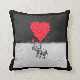 Cute elephant and love heart on grey cushion